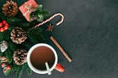 Black Granite Table Decorate With Christmas Theme Gift Box, Pine Leaf And Pine Cones, Holly Balls An poster