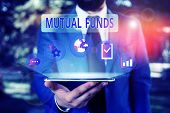 Handwriting Text Mutual Funds. Concept Meaning An Investment Program Funded By Shareholders Individu poster