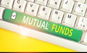 Handwriting Text Writing Mutual Funds. Concept Meaning An Investment Program Funded By Shareholders  poster