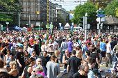 ZURICH - AUGUST 13: 20th Street Parade in Zurich. Crowd of visitors from all over Europe celebrating