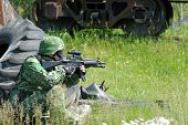 image of hider  - The soldier in protective clothes with weapon - JPG