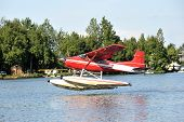 stock photo of float-plane  - A float plane takes off in Anchorage Alaska - JPG