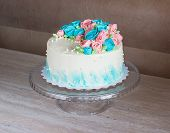 Gorgeous Cake Covered In Bright Roses Made Of Butter Cream Icing On Light Wooden Background poster