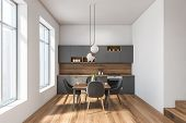 White And Gray Kitchen Interior With Table poster