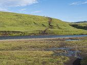 Group Of Hikers Preparing To Ford Across The Blue River Stream At Laugavegur Hiking Trail. Landscape poster