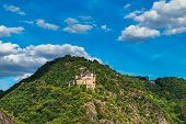 View Of Hilltop Castle On The Side Of Rhine River At Beautiful Summer Day In Germany. Rhine Valley I poster