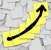 An arrow drawn on several yellow sticky notes to track your success or growth in improving or increa