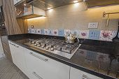 Interior Design Decor Showing Modern Kitchen Cooker Hob Appliance With Extractor Fan In Luxury Apart poster