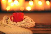 Cup Of Hot Drink On Wooden Table Against Blurred Background, Space For Text. Winter Atmosphere poster