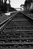 Rail Road Tracks. Train Tracks leading to distant locations.  poster