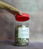 Savings Concept. Coins Saved Inside Container With Save Now Words Written On Paper. poster