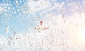 Man In White Clothing Keeping Eyes Closed And Looking Concentrated While Meditating Among Flying Let poster