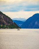 Fjord Landscape With Ship In Norway, Scandinavia Europe. Tourism Vacation And Travel poster