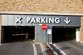 picture of parking lot  - Entrance to the parking lot in stone brickwork wall - JPG