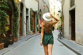 Back View Of Tourist Woman Walking In Florence Street, Italy. Rear View Of Cheerful And Happy Girl I poster
