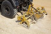 picture of vibration plate  - Road compactor tool compacting gravel at road construction site - JPG