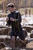 POCONO MANOR, PA - APR 29: A man runs through an obstacle with electrified wires at Tough Mudder on