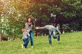 Family Holidays On Nature. Happy Family Having Fun Outdoors. Young Family Enjoying Life, Together On poster