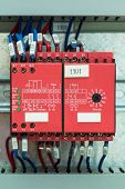 stock photo of contactor  - Wiring with marks on safety relays for emergency stop control in control cubicle - JPG