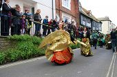 HASTINGS, ENGLAND - MAY 7: Dancers perform during a parade at the Jack In The Green festival on May