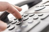 pic of receptionist  - Detail of using a telephone keypad - JPG
