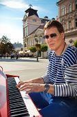 Young pianist play on his piano with bright emotions, Novi Sad, Serbia.