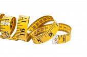 foto of coiled  - A Tailors measuring tape coiled up randomly