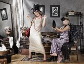 stock photo of ten years old  - Ten years old girls playing with retro fashion accessories - JPG