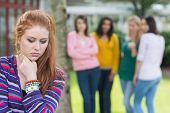 foto of peer-pressure  - Female student being bullied by other group of students - JPG