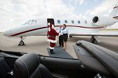picture of cabin crew  - Santa travelling on a private jet meeting cabin crew - JPG