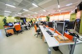 MOSCOW - MAR 5: Employees work in office buildings news agency RIA Novosti with plants and orange fu