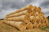 stock photo of cylinder pyramid  - Czech Republic - Ostrava 2013: stack of straw on the field