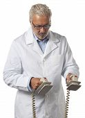 image of defibrillator  - Doctor using a defibrillator on white background - JPG