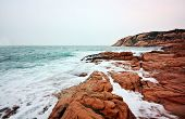 rocky sea coast and blurred water in shek o,hong kong