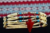 image of cultural artifacts  - Traditional choker necklace of bone coral silver and turquoise in high contrast setting. Artifact of cultural Native American heritage. Closeup in Selective Focus.