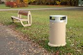 picture of dust-bin  - Dust bin bench and autumn leaves somewhere in park - JPG
