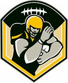 pic of scat  - Illustration of an american football gridiron running back player running with ball facing front fending set inside shield crest with ball on top done in retro style - JPG