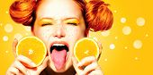foto of freckle face  - Beauty Model Girl with Juicy Oranges - JPG