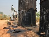 stock photo of nod  - old pumpjack pumping crude oil from oil well - JPG