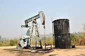 image of oil derrick  - old pumpjack pumping crude oil from oil well - JPG