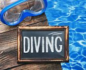 stock photo of rubber mask  - blackboard with the words diving and swim mask - JPG