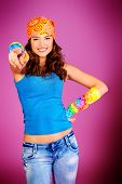 stock photo of debonair  - Cheerful teenager girl in bright casual clothes smiling at the camera - JPG