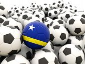 stock photo of curacao  - Football with flag of curacao in front of regular balls - JPG