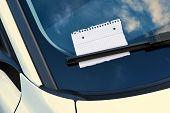 pic of wiper  - sheet of paper under a windshield wiper  - JPG