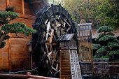 image of water-mill  - Water wheel mill in Hong Kong. Water wheel used for generating power using water flow.