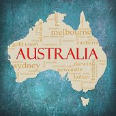 stock photo of aborigines  - A map of Australia on a blue grunge background with different Australian terms around it such as Melbourne Canberra kangaroo aborigines Darwin and a lot more - JPG