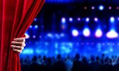pic of opulence  - Hand of businessman opening red velvet curtain - JPG