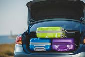 pic of car ride  - Car full of suitcases and bags to return from summer holidays - JPG