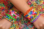 foto of loom  - Loom bracelets colorful rubber in background - JPG