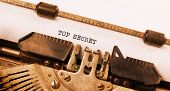 stock photo of top-secret  - Vintage typewriter old rusty warm yellow filter  - JPG